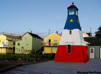 In Cheticamp, the main city in Cape Breton's Acadian country, a lighthouse painted blue, white and red - with a gold star on the blue - evokes the Acadian flag.