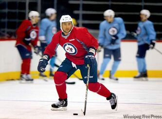 Jets blue-liner Dustin Byfuglien joyously controls the puck during a Friday workout. Playing with the puck is a big part of the master plan.