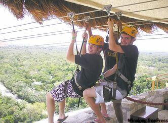 Dylan and new friend Nick riding tandem on the zip-lines at the Xplor park in the Mayan Riviera.