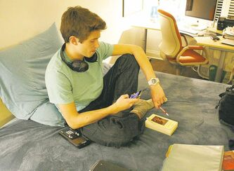 Donald Conkey, 15, checks his smartphone while doing homework in his bedroom in Wilmette, Ill. A report from the Pew Internet & American Life Project says more teens are using smartphones as a means of accessing the Internet.