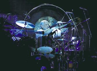 Mick Fleetwood hits the drums