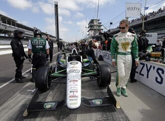 Ed Carpenter, who will start the race from the pole, looks over his car in pit lane before the start of the final practice session for the Indianapolis 500 on Friday.