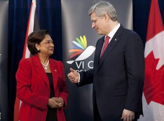Canadian Prime Minister Stephen Harper speaks with Trinidad and Tobago Prime Minister Kamla Persad-Bissessar during a bi-lateral meeting at the sixth Summit of the Americas in Cartagena, Saturday April 14, 2012. THE CANADIAN PRESS/Adrian Wyld