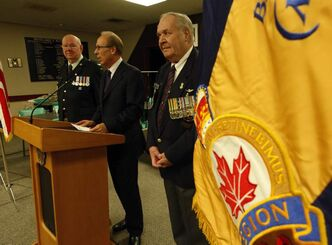 Mayor Sam Katz (centre) with Col. Bob Vanderwater (left) and John Gillis of the Royal Canadian Legion  at announcement this morning.
