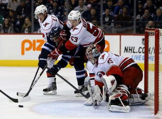 On an aggressive penalty kill, Winnipeg Jets' Evander Kane is stuck between Carolina Hurricanes' Eric Staal (left) and Jeff Skinner (53) in front of goaltender Justin Peters during the second of Saturday's game.