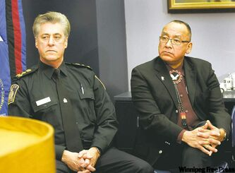 Police Chief Keith McCaskill (left) at a news conference with Ron Evans, Grand Chief of the Assembly of Manitoba Chiefs. Mc-Caskill says there's no evidence police officers took an aboriginal youth to the outskirts of the city and abandoned him there.