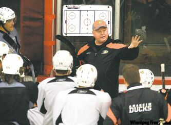 New Ducks head coach Bruce  Boudreau (above)conducts his first practice with the NHL team on Thursday. Teemu Selanne (far left) doesn�t want to miss a word. At left, fired coach Randy Carlyle sums up Anaheim�s season to date.