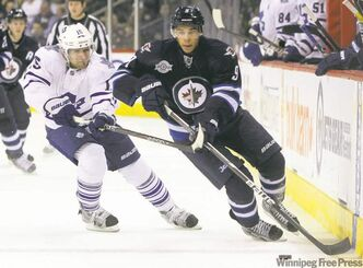 Winnipeg's Evander Kane takes the puck over the Leafs' blue-line Saturday night while Toronto's Matthew Lombardi gives chase.