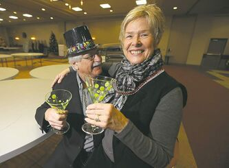 Ray and Linda Antymis at the Viscount Gort, toasting their Adventures for Successful Singles gala on New Year's Eve.