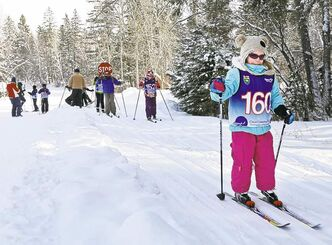 Children head off for cross-country skiing and games on Sunday afternoon as part of World Snow Day in Riding Mountain National Park. The weekend event was held to help draw public attention to the park's value in the wake of federal funding cuts to national parks.