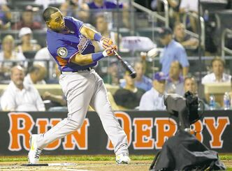 The American League's Yoenis Cespedes, of the Oakland Athletics, belts one out on Monday.