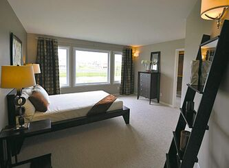 The bedroom wing offers a powder room, huge secondary bedroom and an opulent master suite.