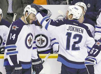 Mark Humphrey / the associated pressAnthony Peluso celebrates with Olli Jokinen after scoring his first NHL goal.
