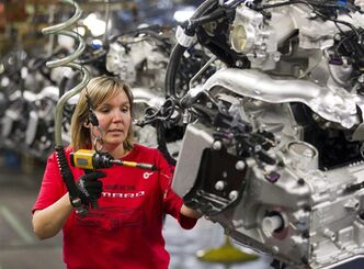 Engine Specialist Jennifer Souch assembles a Camaro engine at the GM factory in Oshawa, Ontario on Friday, June 10, 2011. The Canadian Auto Workers union says General Motors is going ahead with plans to close its consolidated plant in Oshawa. Some of the production of the new Chevy Impala will shift to the flex assembly plant which currently makes the Chevy Camaro, Buick Regal and soon, the Cadillac XTS. THE CANADIAN PRESS/Frank Gunn