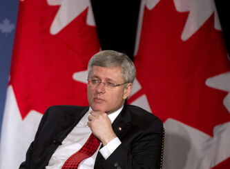 Prime Minister Stephen Harper participates in a question and answer session with the Greater Kitchener Waterloo and the Cambridge Chambers of Commerce in Kitchener, Ont., on Friday.