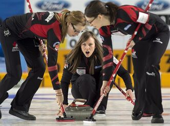 Canada's skip Rachel Homan directs Alison Kreviazuk, left, and Lisa Weagle, right, as they play Germany at the world women's curling championship in Riga, Latvia on Wednesday, March 20, 2013. THE CANADIAN PRESS/Andrew Vaughan