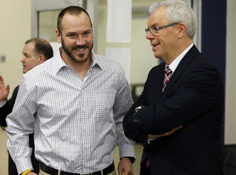 Blue Bombers' RB coach Buck Pierce and Premier Greg Selinger attend Thursday's opening.