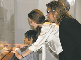 Angelina Jolie sports an engagement ring as the couple, with their son, Pax, view a display at the Los Angeles County Museum of Art.