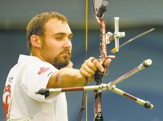 Canada's Jay Lyon shoots an arrow during the elimination round of men's individual archery at the Beijing 2008 Olympics in Beijing, Wednesday, August 13, 2008. Lyon beat Brady Ellison of the U.S. in the round. (AP Photo/Saurabh Das )