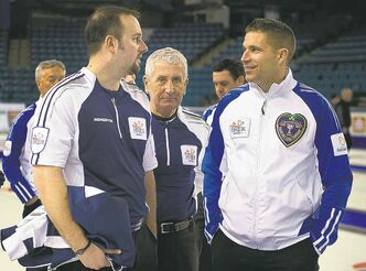 Nova Scotia skip Jamie Murphy (left) chats with B.C. skip John Morris, who could pose the biggest threat to Jeff Stoughton.