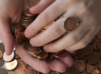 Renee Gruszecki displays jewelry she designs from coins at her studio, Coin Coin designs & co., in Halifax on Saturday, Feb. 2, 2013. Many of Gruszecki's personalized creations feature the Canadian one cent coin which has been phased out by the federal government in a cost-saving move. THE CANADIAN PRESS/Andrew Vaughan