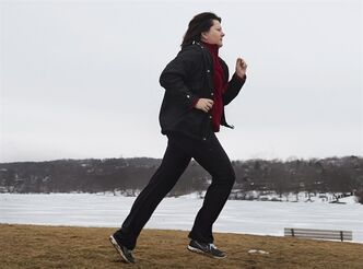 Kim Smith runs along the shores of Lake Banook in Dartmouth, N.S., on Saturday, Feb. 16, 2013. THE CANADIAN PRESS/Andrew Vaughan