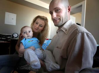 Ernest Dlutek and his wife, Justyna Pikiewicz, with their baby, Antoni. They came to Canada in April 2013 on a one-year work visa.
