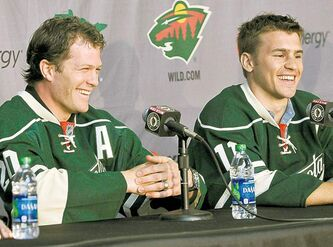 At the same time NHL bossman Gary Bettman was complaining about the costs of player salaries, the Minnesota Wild dropped $196 million on these two: free agents Ryan Suter (left) and Zach Parise.