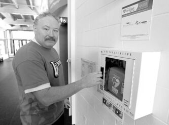 BORIS MINKEVICH / WINNIPEG FREE PRESS  Sturgeon Heights Community Centre manager Barry Chambers with his facility's AED.
