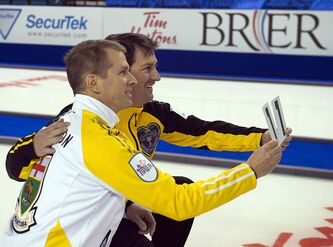 Manitoba skip Jeff Stoughton andt New Brunswick skip James Grattan pose for a photo as they mark their11th appearance at the Tim Hortons Brier in Kamloops, B.C. on Friday. Stoughton is widely considered the heavy favourite to once again win this year's Brier.