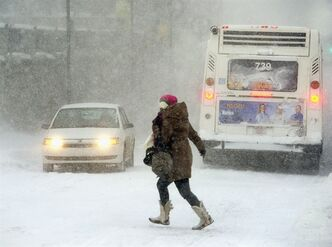 A pedestrians braves the blizzard conditions in Halifax on Friday, Jan. 3, 2014. THE CANADIAN PRESS/Andrew Vaughan