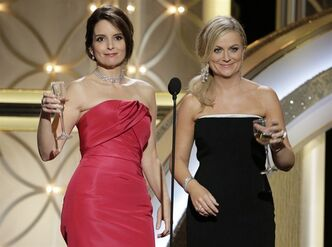 This image released by NBC shows hosts Tina Fey, left, and Amy Poehler during the 71st annual Golden Globe Awards on Sunday, Jan. 12, 2014, in Beverly Hills, Calif. THE CANADIAN PRESS/AP, NBC, Paul Drinkwater