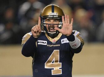 Winnipeg Blue Bombers QB Buck Pierce signals the bench during fourth-quarter play against the Hamilton Tiger-Cats.