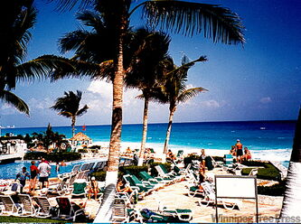 The best Cancun hotels are situated on a white sandy beach facing the Caribbean Sea.