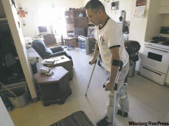 Marvin Sumner works to regain control of his legs in his inner-city apartment. After two failed attempts to quit sniffing, he finally went clean as a birthday present to his dad.