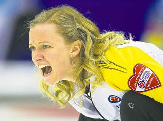 Team Manitoba skip Chelsea Carey shouts after delivering her rock to team Quebec during draw 12 curling action at the Scotties