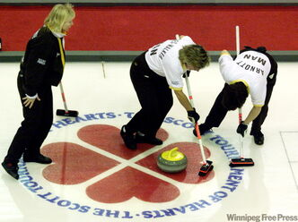 Manitoba skip Connie Laliberte left follows her stone down the ice as team second Debbie Jones-Walker centre, and lead Janet Arnott sweep during first draw competition against Team Canada in Charlottetown in 1999.