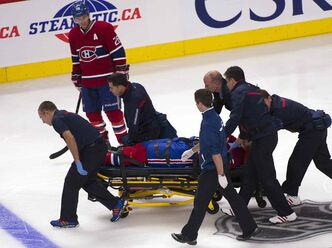 Montreal Canadiens right wing George Parros (15) is taken off on a stretcher after Parros hit his head on the ice during a fight with Toronto Maple Leafs right wing Colton Orr, Monday, in Montreal.