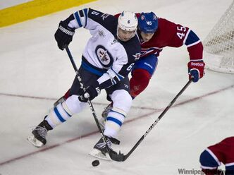 Winnipeg Jets' Ron Hainsey, right, says players have taken issue with the fairness of qualifying for the playoffs and travel issues in a propsoal approved by the NHL's board of governors.