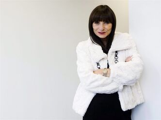 Host of Fashion Television and fashion icon Jeanne Beker poses for a photograph wearing her own brand outfit called Edit by Jeanne Beker in Toronto on Wednesday, August. 25, 2010. Beker broke the news on Twitter Wednesday that the long-running television fashion show is no more. THE CANADIAN PRESS/Nathan Denette