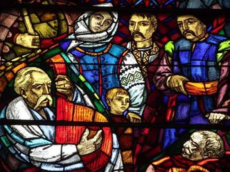 A group of devoted Ukrainians gathers to sing praises to the Blessed Virgin Mary in a detail of a stained-glass window by Leo Mol.