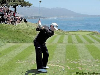 Tim Clark of South Africa hits a tee shot on the seventh hole during a practice round for the U.S. Open golf tournament on Wednesday at the Pebble Beach Golf Links in Pebble Beach, Calif.