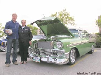 Reinhard Wilzer and his stunning 1956 Chevrolet, with Betty Lannoo from the Fabulous 50's Ford Club of Manitoba.