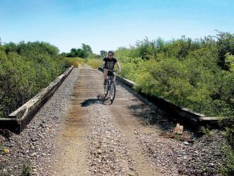 The 20-kilometre Miami-Altamont Trail still utilizes old rail bridges.