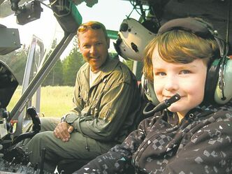 Pilot Perry Hirsch makes sure his passengers � especially the little ones � get comfortable in the helicopter.