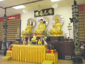 The golden statues in the Huasing Buddhist Temple on Cumberland Avenue represent infinite wisdom, life and compassion.