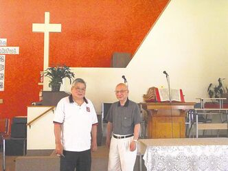 Kin-Chung Choi and Jack Chan, elders with the historic Chinese United Churchon Pacific Avenue in Chinatown.
