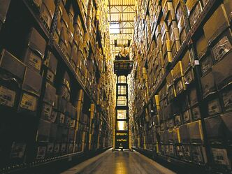 Kyle Grantham / The Associated Press archives Daniel Holmquist grabs a product for shipping off the top shelf of the Sierra Trading Post Fulfillment Center's racks.