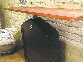 A shelf made from an old radiator shroud.