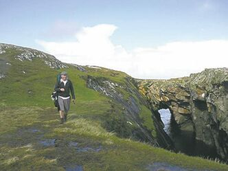 "UNDATED � Brian Hughes of Connemara Safari Walking Holidays leads the way on a hike around Inishbofin � ""island of the white cow"" one of dozens of islands off the coast of Ireland, about a 40-minute ferry ride. The company offers day long and multi-day tours around the islands.    (Lisa Monforton, Calgary Herald) FOR POSTMEDIA NEWS TRAVEL PACKAGE, AUGUST 1."